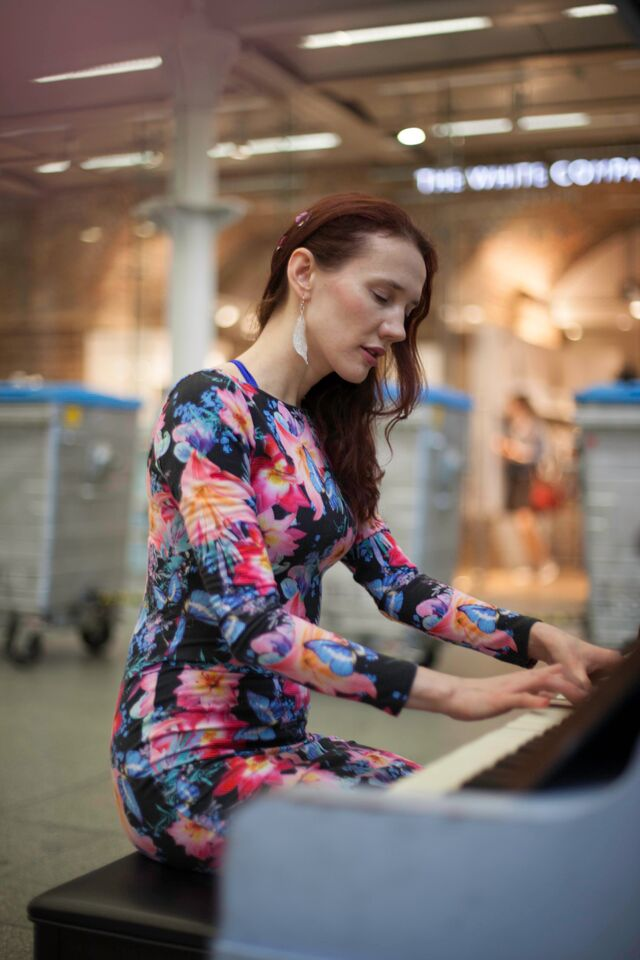 7/7/2015 - playing my songs to passengers at St Pancras station, photographed by James Hall - as part of the series honoring Polish artists living in UK -  ©James Hall at justaddpictures.com